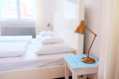 Ein Bett oder Betten in einem Zimmer der Unterkunft Hotel Maurerhansl