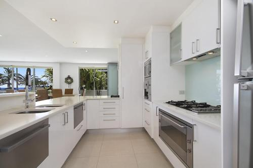 A kitchen or kitchenette at Golden Four Drive - Luxury Four Bedroom Apartment with private plunge pool