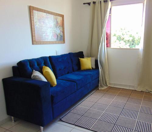 A seating area at Apartamento aconchegante na região central de Cuiabá