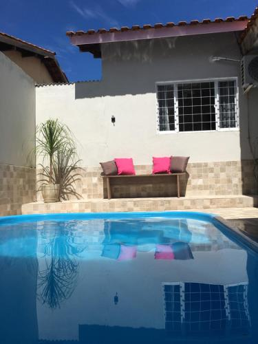 The swimming pool at or near Casa confortável para a família toda