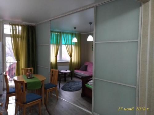 Гостиная зона в Apartment Kaliningradsky prospekt 71A