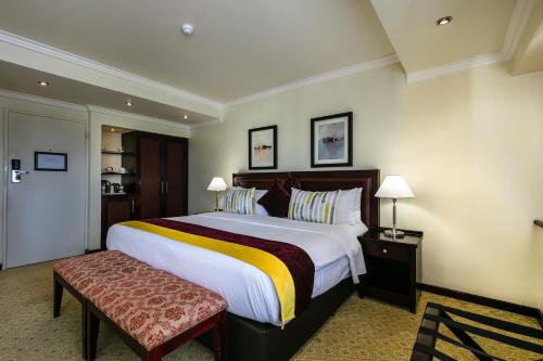 A bed or beds in a room at Cresta President Hotel