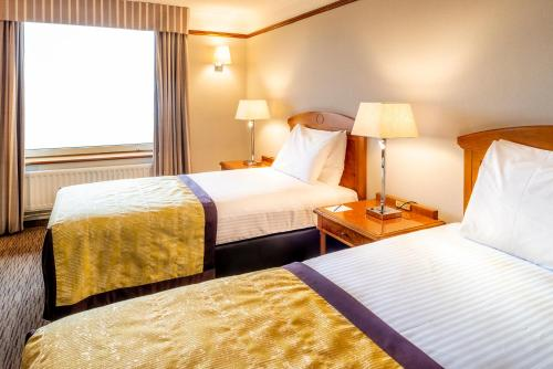 A bed or beds in a room at Copthorne Hotel Merry Hill Dudley
