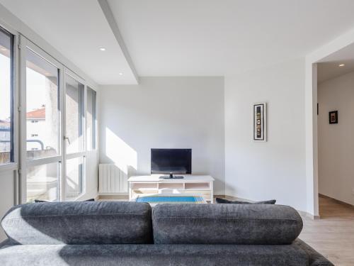 A television and/or entertainment center at Appart Coeur de Lyon - Part Dieu - Paul Bert