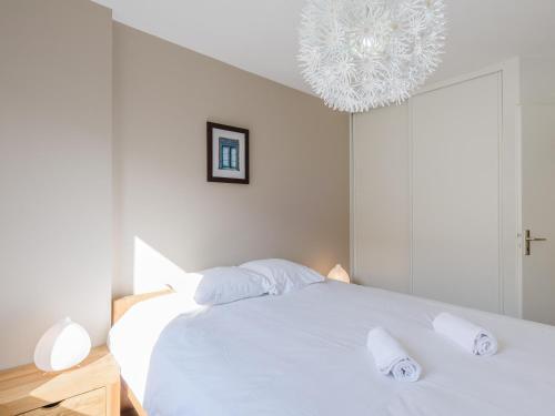 A bed or beds in a room at Appart Coeur de Lyon - Part Dieu - Paul Bert