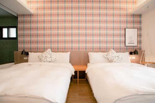 A bed or beds in a room at Love Tour