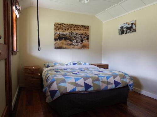 A bed or beds in a room at Dunstan Downs High Country Sheep Station