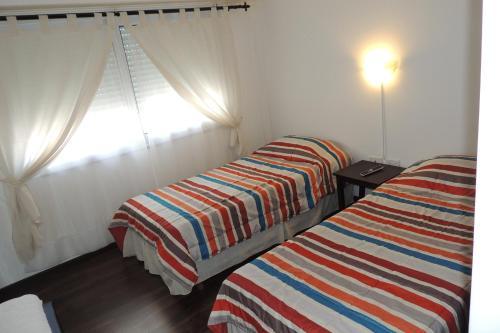 Una cama o camas en una habitación de Chivilrent