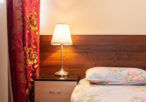 A bed or beds in a room at Apartments at Alexandrinsky Theatre