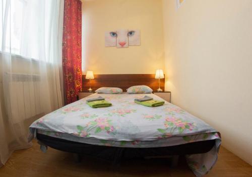 Кровать или кровати в номере Апартаменты у Александринского Театра