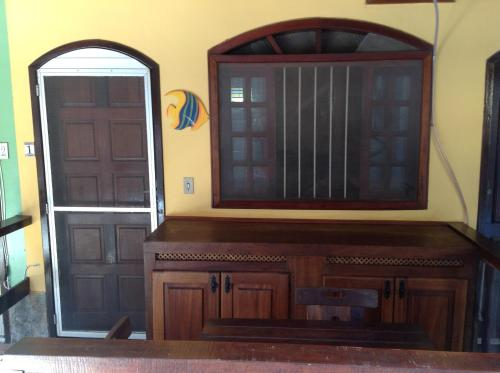 A television and/or entertainment centre at Angel Ilha Flats