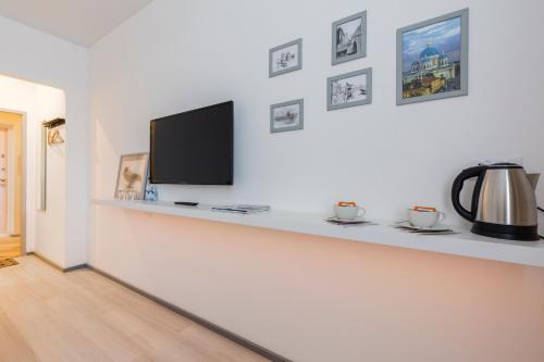 Телевизор и/или развлекательный центр в Guesthouse MyInn
