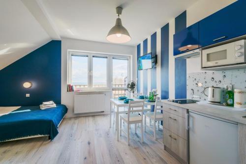 Kuchnia lub aneks kuchenny w obiekcie Apartamenty NCNK Cztery Kąty w Kątach Rybackich