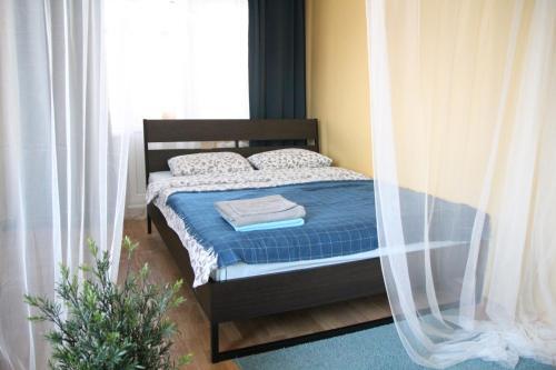 Кровать или кровати в номере Академическая 23