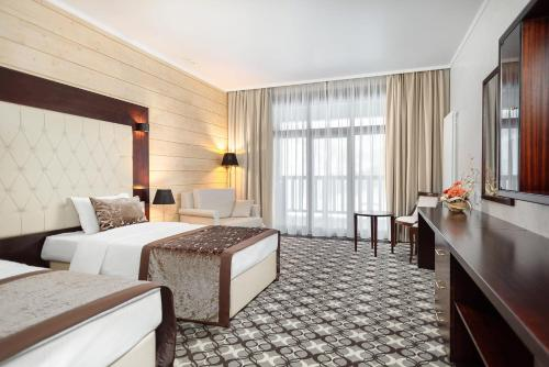 A bed or beds in a room at Altay Resort