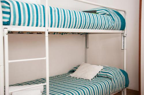 A bunk bed or bunk beds in a room at Case Vacanza Torre Canne