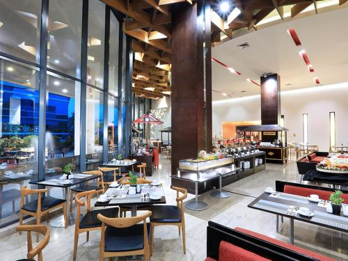 A restaurant or other place to eat at Aston Palembang Hotel & Conference Centre