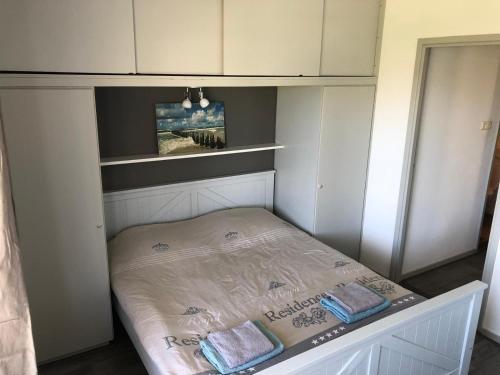 Un ou plusieurs lits dans un hébergement de l'établissement Appartement Dishoek