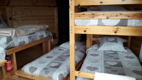 A bunk bed or bunk beds in a room at Roulotte-Cabane de la Vallette