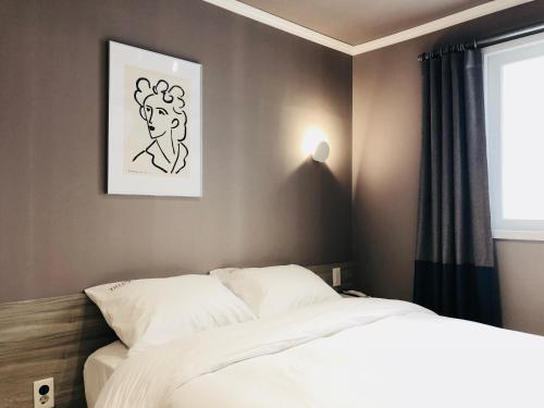 ティント ホテルにあるベッド