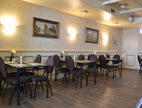 Een restaurant of ander eetgelegenheid bij Fletcher Hotel De Zalm