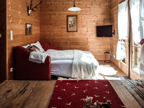 Ein Bett oder Betten in einem Zimmer der Unterkunft Weigl Hütte Semmering