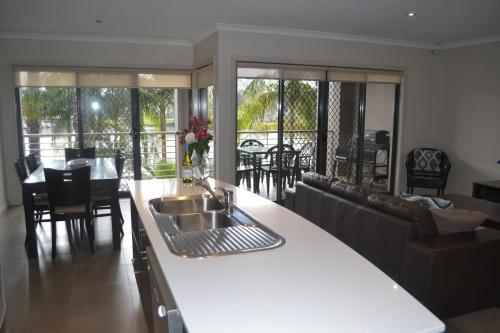 A kitchen or kitchenette at Cypress Waterview Spa Apartment - 37B
