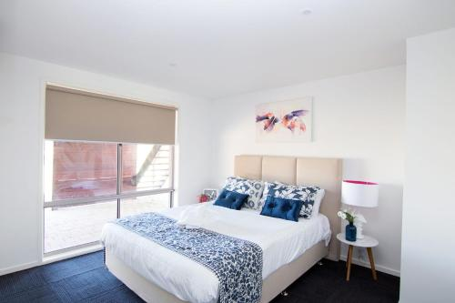 A bed or beds in a room at Paradise Waters - Yarrawonga