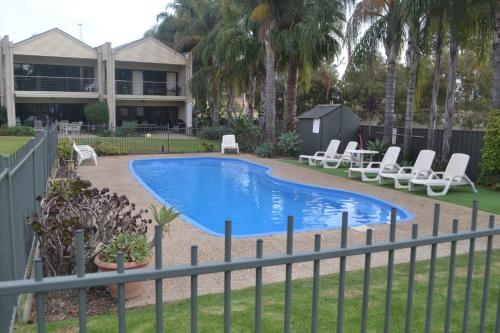 The swimming pool at or near ELSINOR Townhouse 4 Mulwala