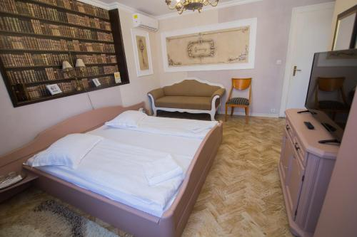 Cama ou camas em um quarto em Vila Sibiu