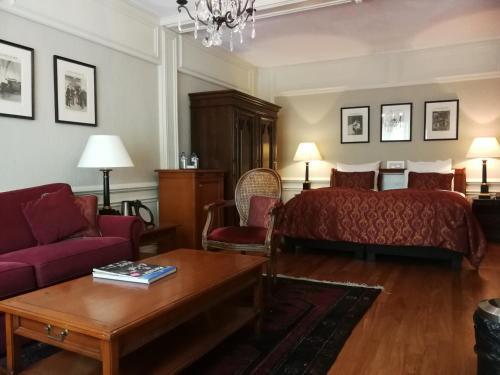 Un ou plusieurs lits dans un hébergement de l'établissement Apollofirst Boutique Hotel