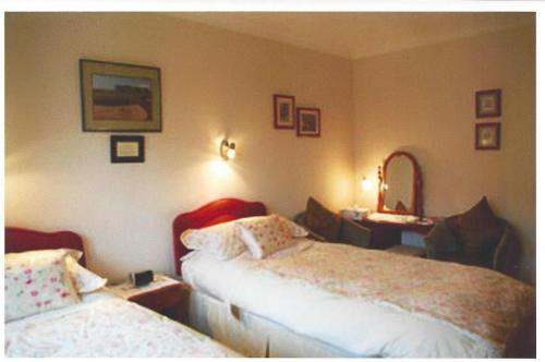 A bed or beds in a room at Ashcroft Farmhouse