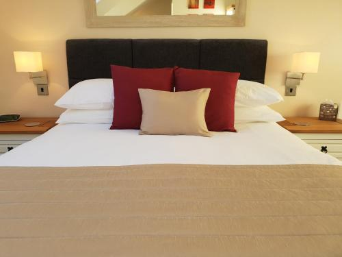 A bed or beds in a room at Compston House B & B
