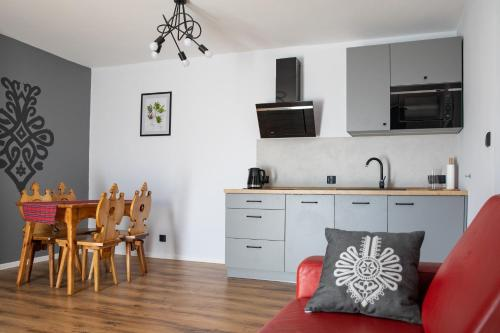 Kuchnia lub aneks kuchenny w obiekcie 5 Wierchów Apartamenty