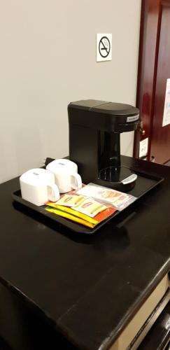Coffee and tea-making facilities at Best Western Plus Belize Biltmore Plaza