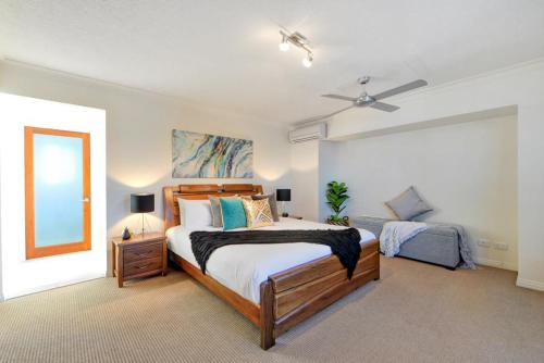 A bed or beds in a room at Mermaid Island Beach House