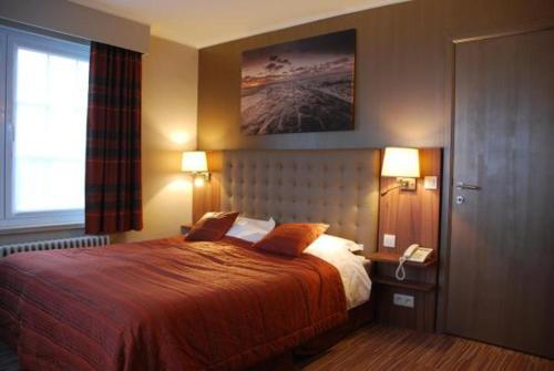 Ein Bett oder Betten in einem Zimmer der Unterkunft Hotel Rubens