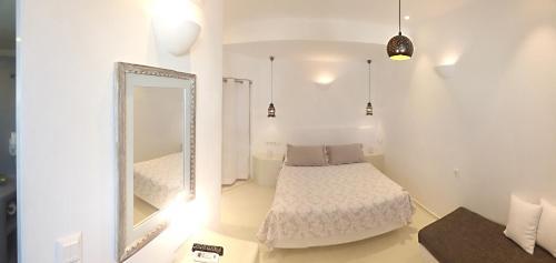 Ένα ή περισσότερα κρεβάτια σε δωμάτιο στο Ξενοδοχείο Τατάκη