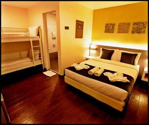 A bed or beds in a room at DWJ Hotel Ipoh