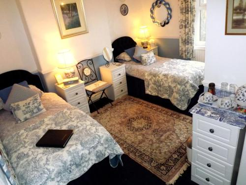 A bed or beds in a room at Park Place Guesthouse