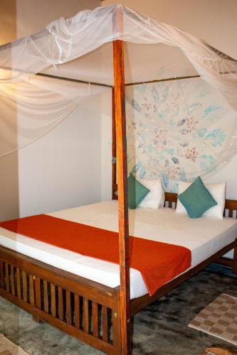A bed or beds in a room at Mellow Hostel Sri Lanka