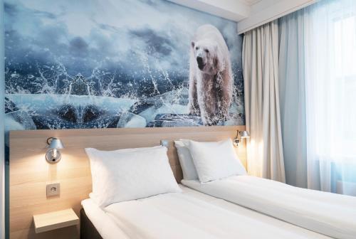 Un ou plusieurs lits dans un hébergement de l'établissement Thon Hotel Polar