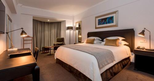 ホテル アベニーダにあるベッド