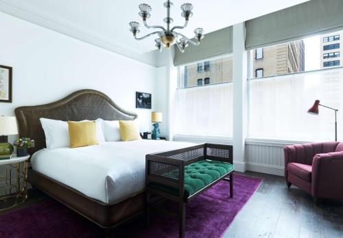 A bed or beds in a room at The Beekman, a Thompson Hotel