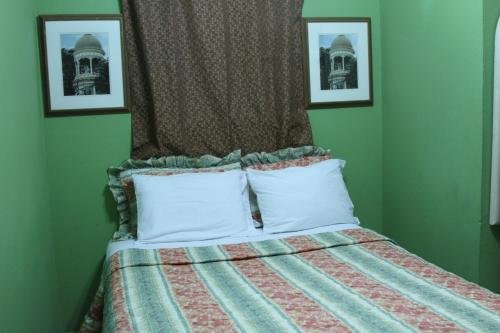 A bed or beds in a room at La Maison Hotel