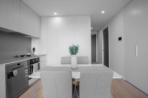 A kitchen or kitchenette at [Grey Style] Simple and Cozy Apt@Parkville+Carpark