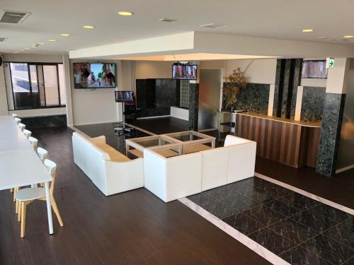 The lobby or reception area at Prime Hotel Fulula (Adult Only)