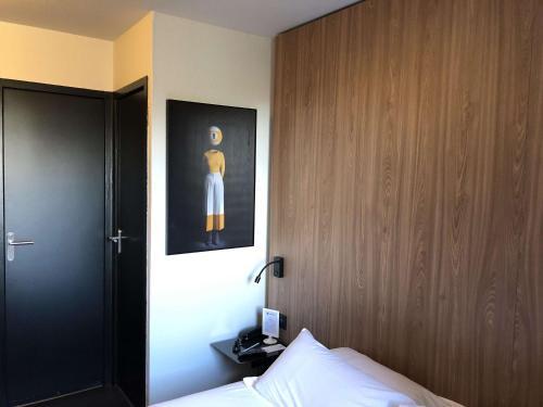 Ein Bett oder Betten in einem Zimmer der Unterkunft Best Western Bridge Hotel Lyon East