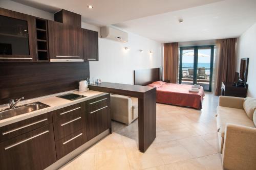 A kitchen or kitchenette at Marina City ApartHotel