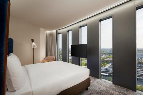 A bed or beds in a room at Hyperion Hotel München